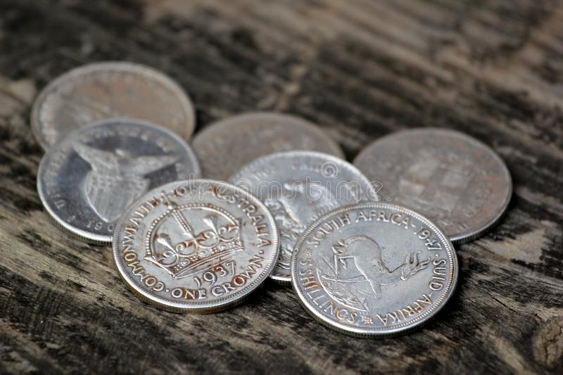Old silver coins as souvenirs on wooden table.  royalty free stock images