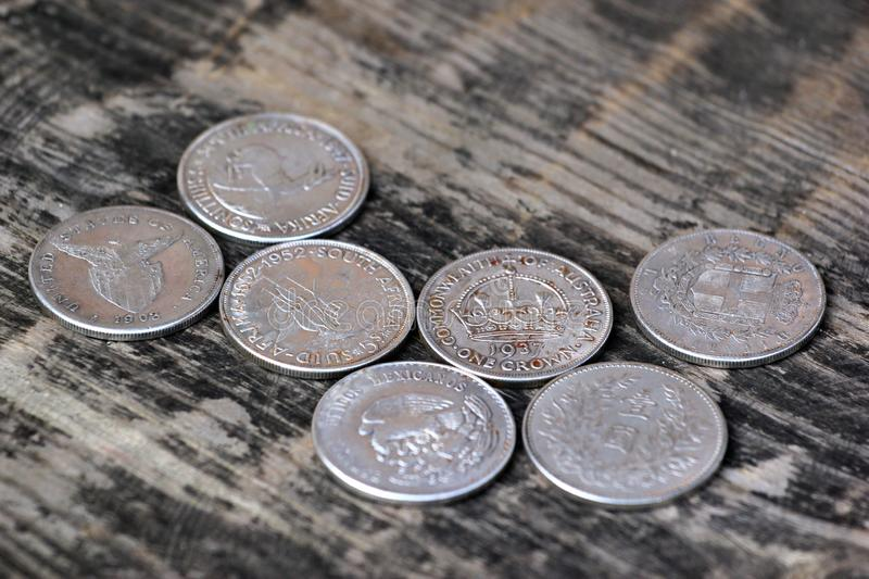 Old silver coins as souvenirs on wooden table.  royalty free stock photography