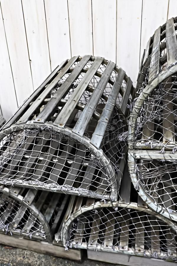Old silver color metalic cages. For lobster and crab fishing stock photo