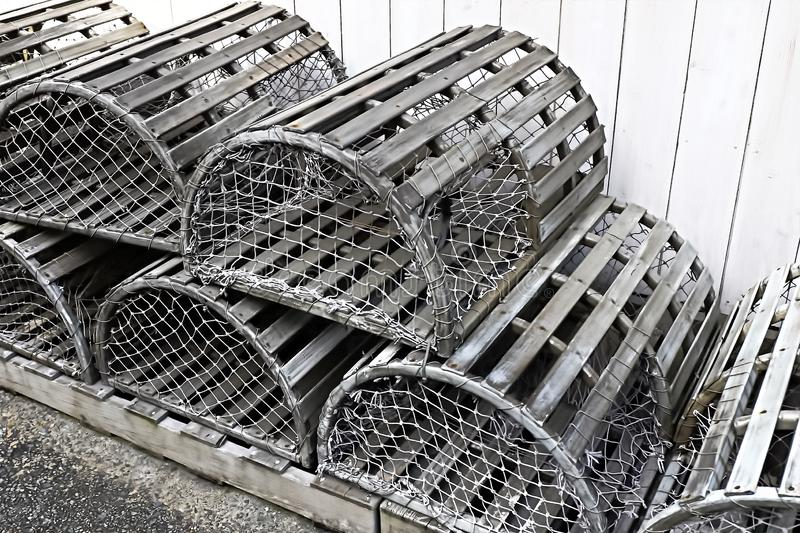 Old silver color metalic cages. For lobster and crab fishing stock image