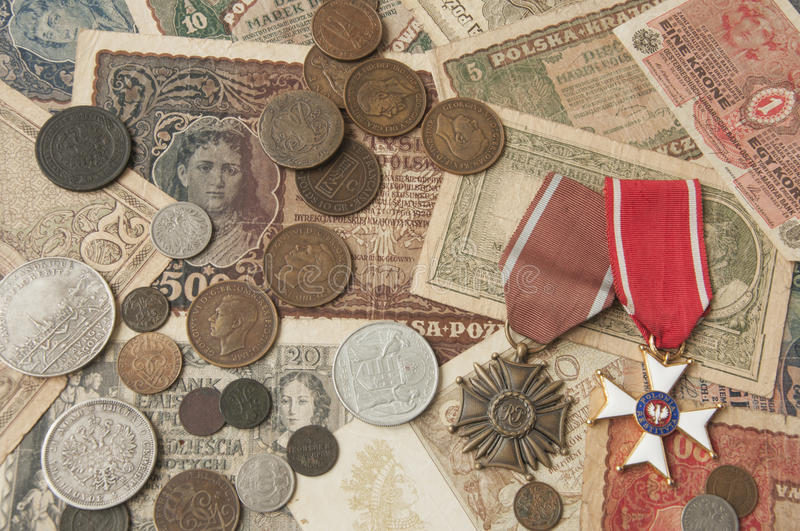 Old silver and copper coins with banknotes and medals background. Background with the image of the old banknotes, as well as copper and silver coins and medals royalty free stock photo