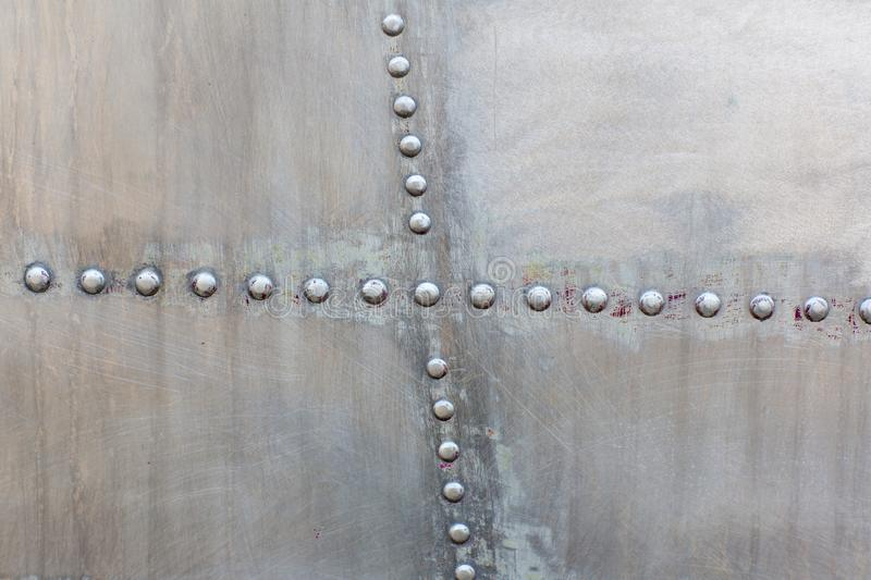 Old silver metal surface of the aircraft fuselage with rivets. Iron plate,steel sheet texture,pattern and background. stock photo