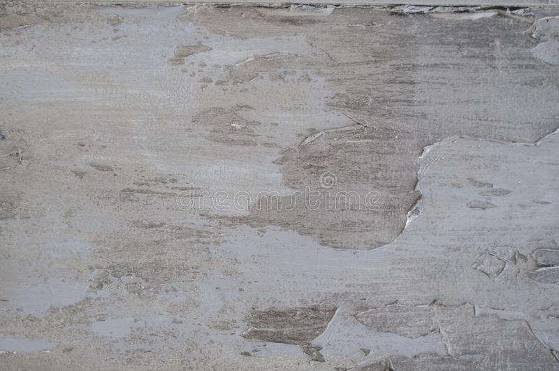 Seamless Old White Cement Wall Paint pealing Cracks Texture for background and design art work. Old Simple White Cement Wall grungy. Texture for background and royalty free stock photos