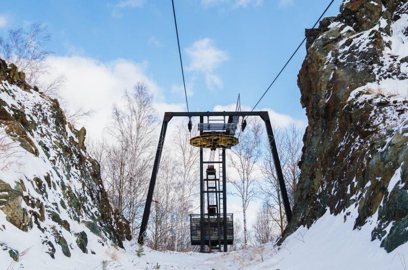 Old ski lift. Installed between the rocks. Ski resort `Mountain Ezhovaya stock image
