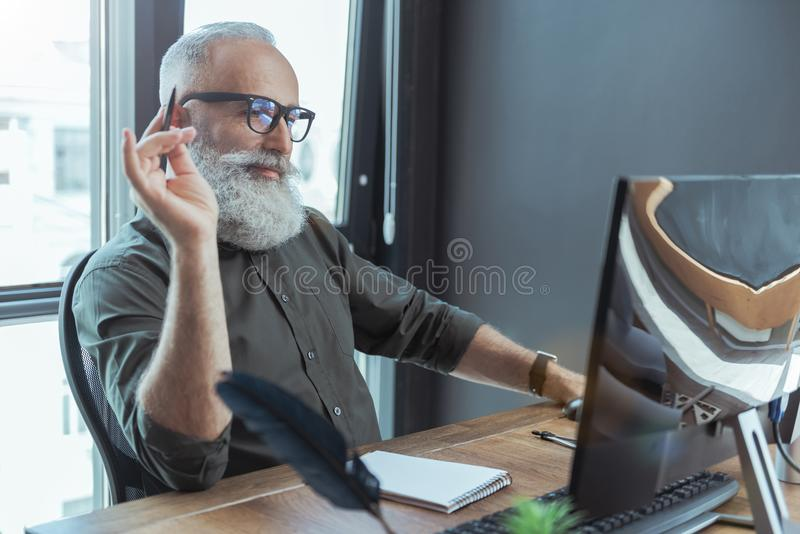 Old skillful writer is creating masterpiece royalty free stock photography