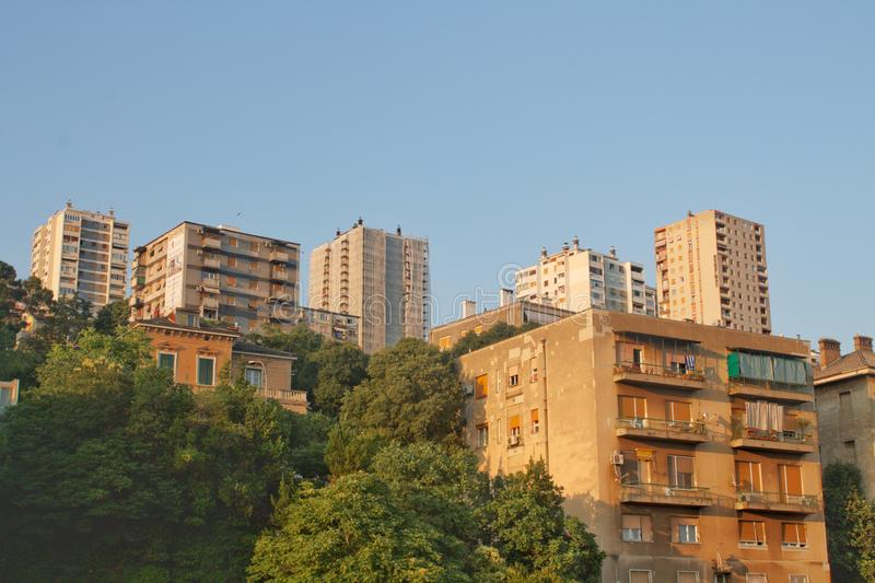 Old Skyscrapers in Rijeka in Croatia. Slowly gets covered by green trees royalty free stock photos