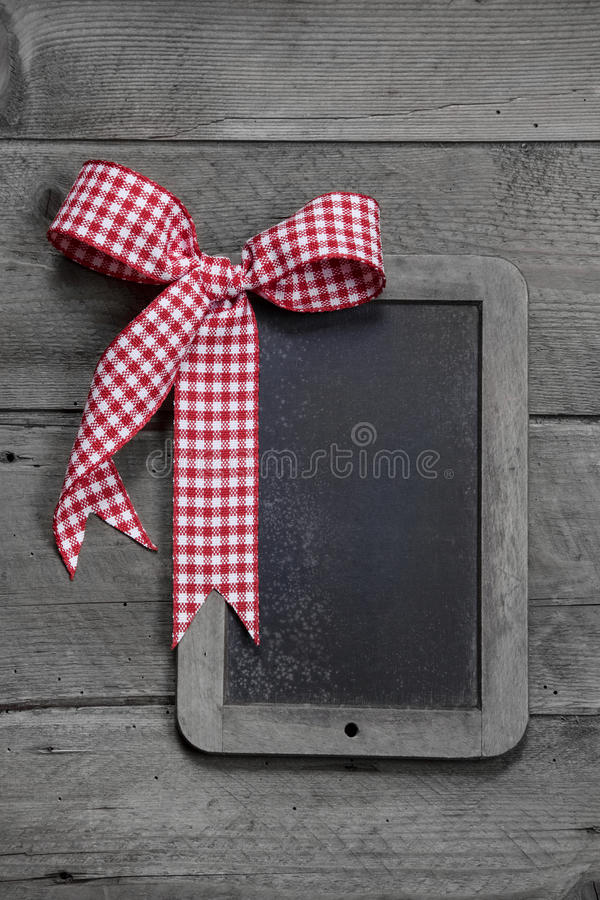 Old slate - empty black chalkboard for a greeting card or a wooden board for advertising stock photo