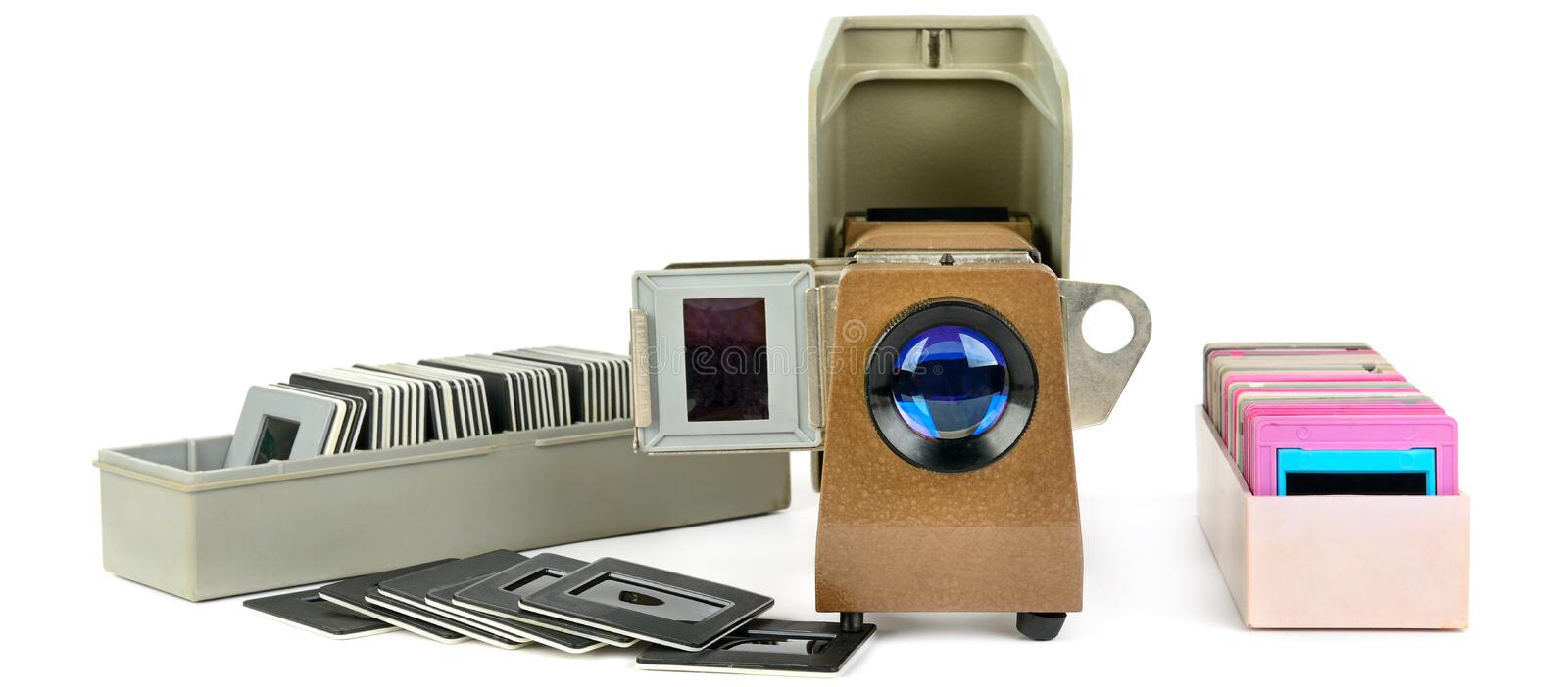 Old slide projector and set of slides isolated on white background. Wide photo royalty free stock photos
