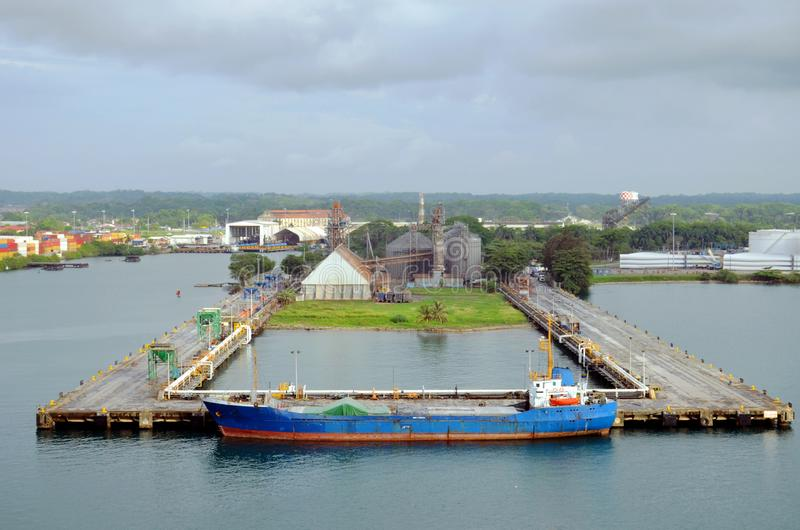 An old cargo ship berthing in the port of Cristobal, Panama stock photo