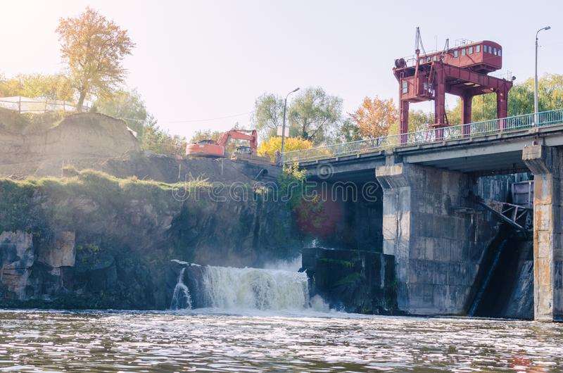 An old small dam with one open gateway.  stock images