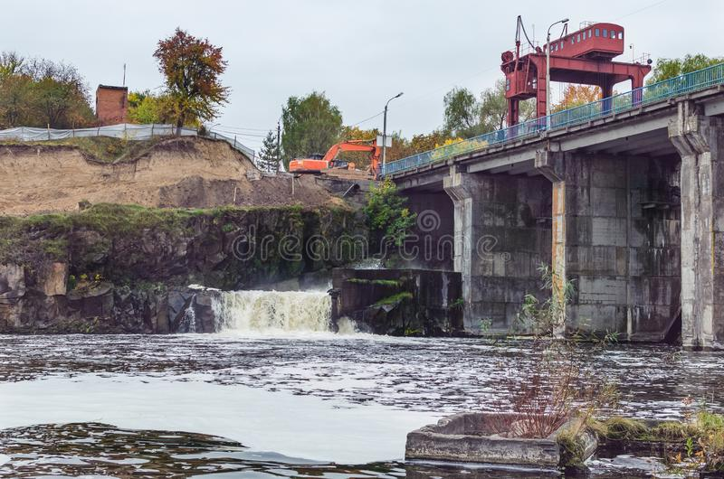 An old small dam with one open gateway.  royalty free stock image