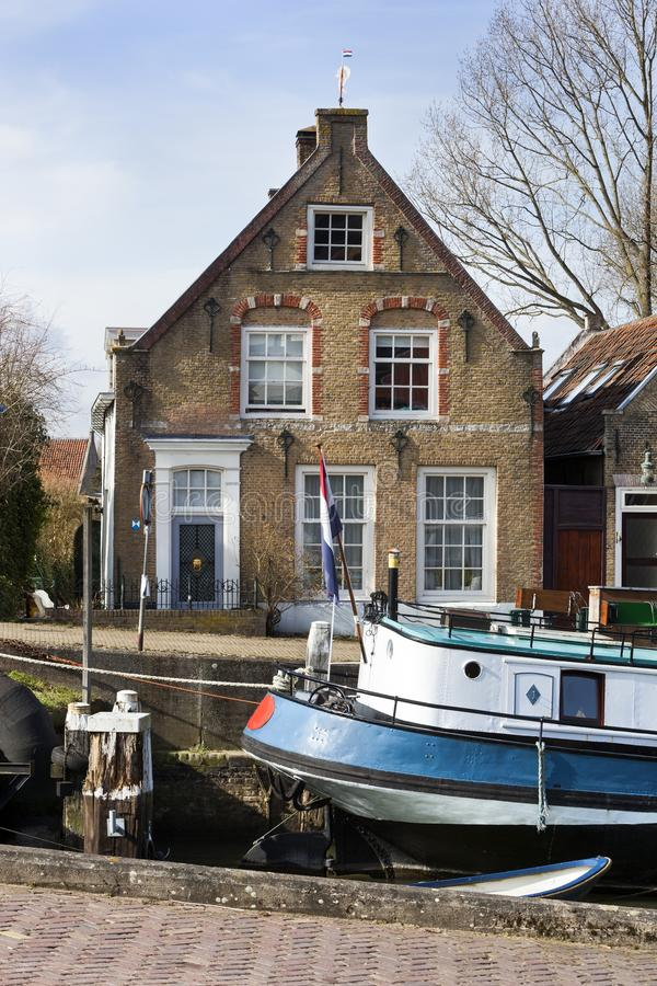 Old small port and historical houses. In Puttershoek in the Netherlands royalty free stock photography