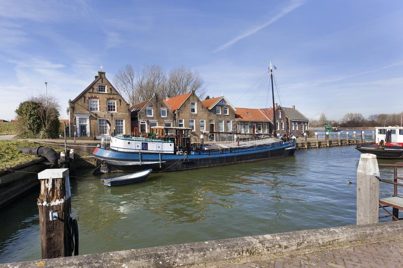 Old small port and historical houses. In Puttershoek in the Netherlands stock photos