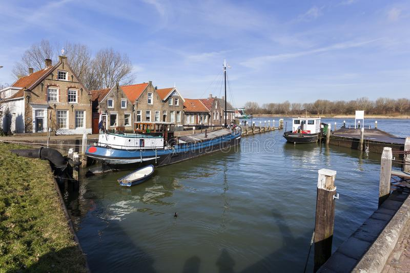 Old small port and historical houses. In Puttershoek in the Netherlands royalty free stock photo