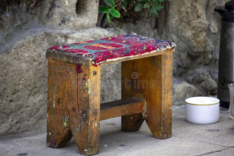 Old small traditional bench in the street. An old differently colored small traditional bench in the street royalty free stock photos
