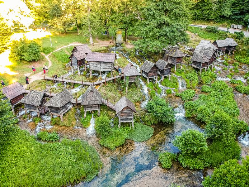Old small wooden mills Mlincici near Jajce on Plivsko Lake in Bosnia and Herzegovina.  stock photos