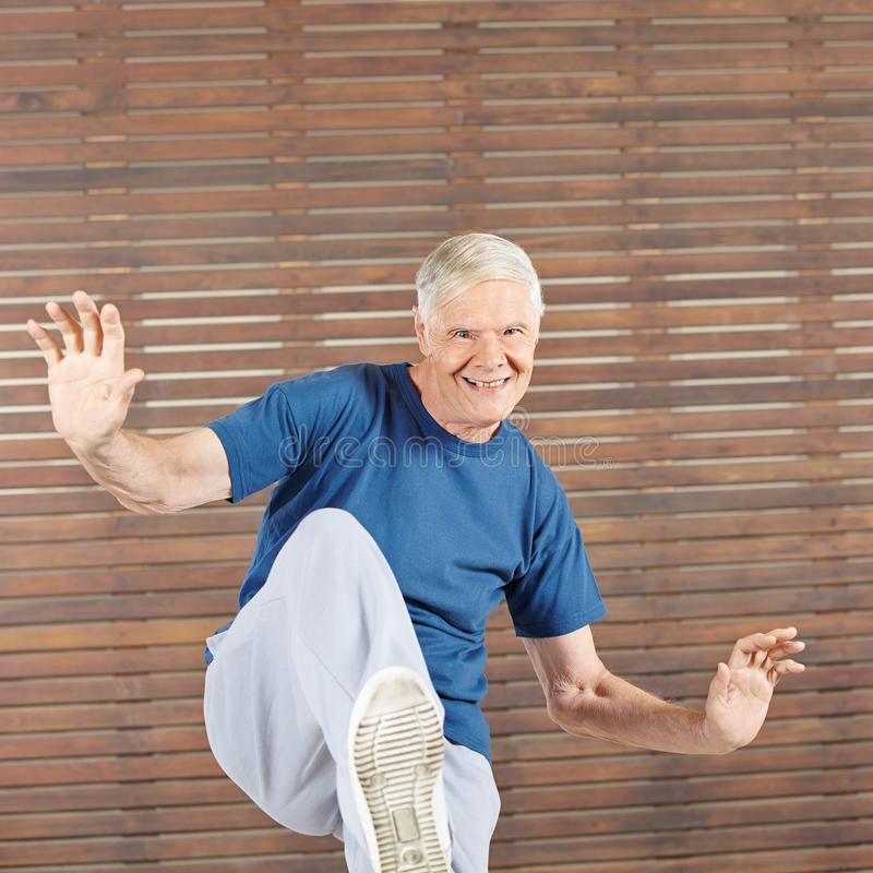Old man stays active in the fitness center royalty free stock images