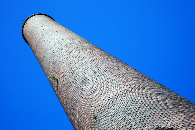 Old smoke stack industrial chimney. Old obsolete smoke stack industrial chimney from the Industrial Revolution stock images