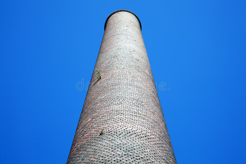 Old smoke stack industrial chimney. Old obsolete smoke stack industrial chimney from the Industrial Revolution stock photo