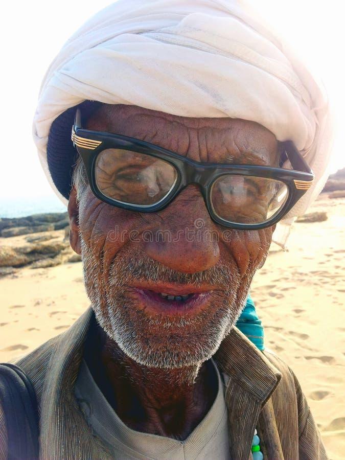 Old Snake Charmer on Beach in Karachi, Pakistan. An Elderly Snake Charmer on French Beach in Karachi, Pakistan royalty free stock photos