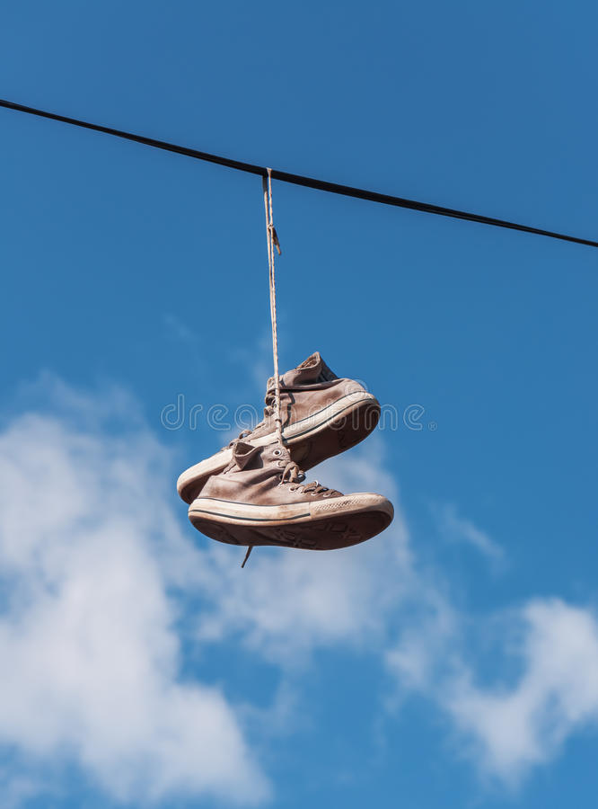 Old sneakers on a wire stock photo. Image of pair, hanging - 61962004
