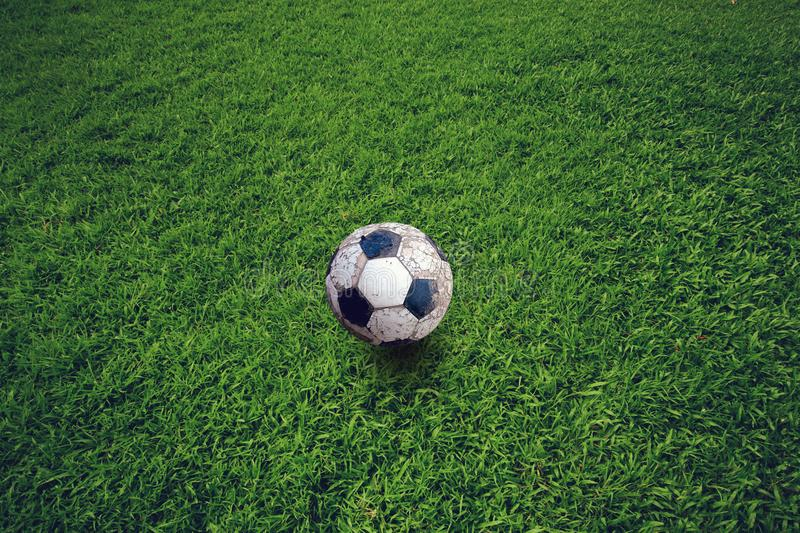 Old soccer ball left on the lawn. royalty free stock photography
