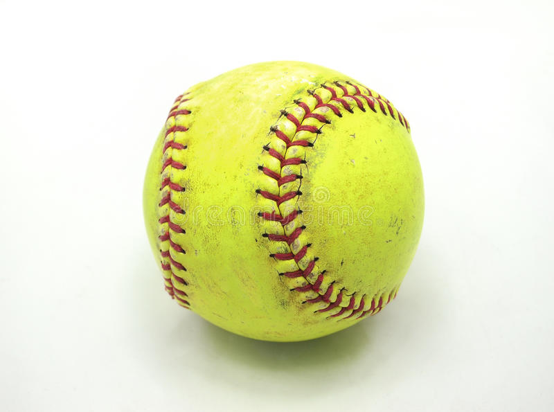 Old Softball. An old softball over white background stock photography