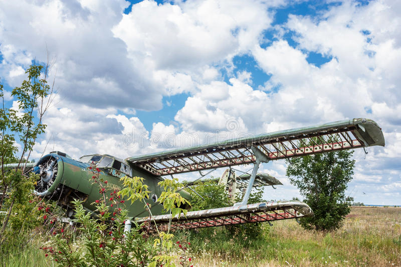 Old soviet biplane Antonov An-2 Colt aircraft. On an abandoned airfield in Ukraine royalty free stock photography