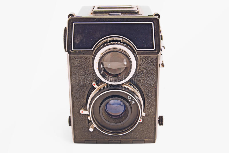 Old Soviet film camera with lens on white background close-up.  stock photo
