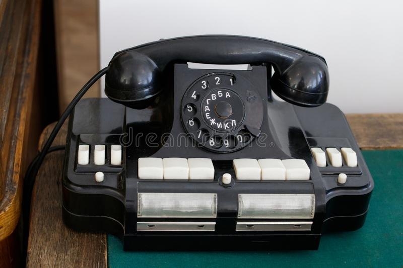 An old Soviet office telephone with Russian letters on a wooden table royalty free stock photos