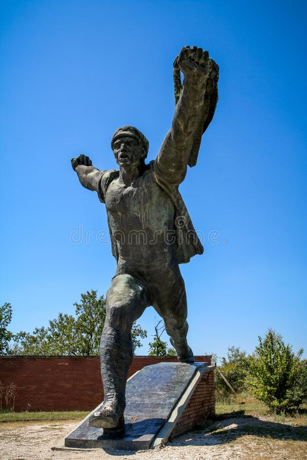 Old Soviet style statue in the Memento Park. Budapest, Hungary. Budaors, Budapest, Hungary - Aug 19, 2008: Old Soviet style statue in the Memento Park. Budapest royalty free stock photos
