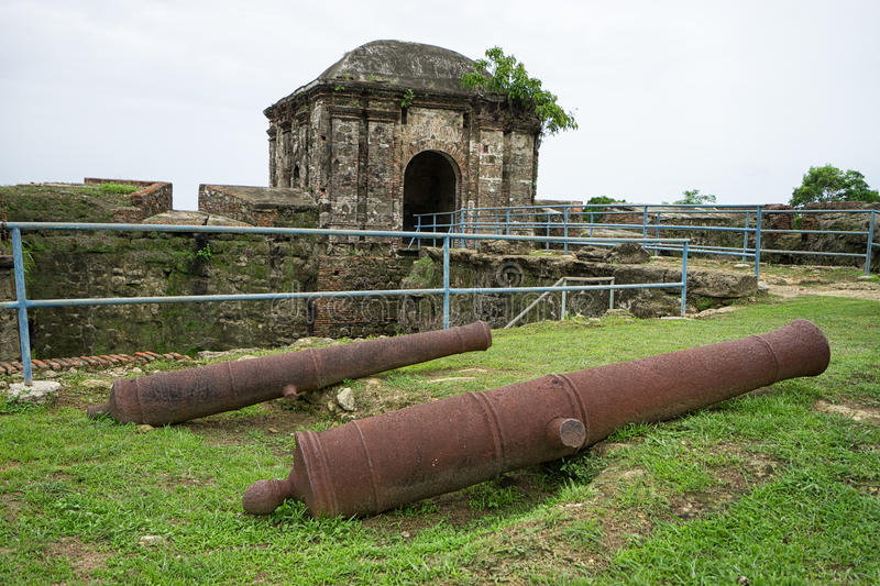 Old spanish cannons in Panama. Cast iron cannons at the entrance to the ruins of fort San Lorenzo a world heritage site royalty free stock image