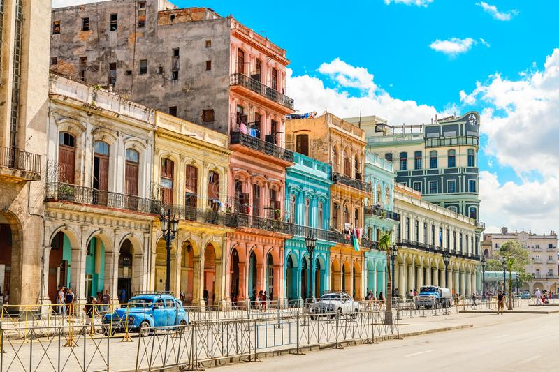 Old Spanish colonial living colorful houses across the road in t. He center of Havana, Cuba royalty free stock image