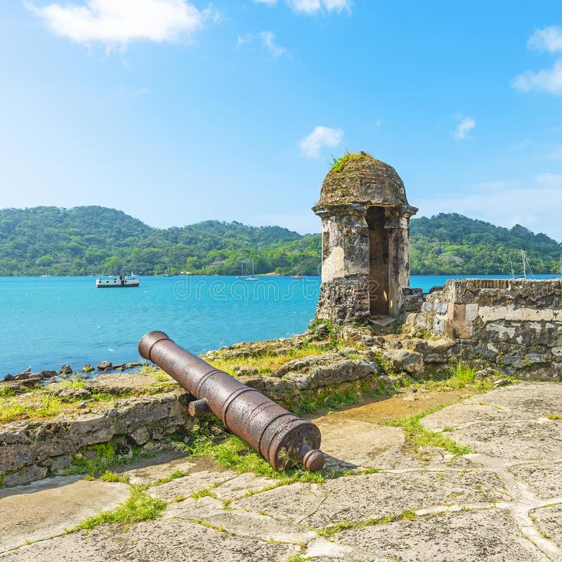 Spanish Fort in Portobelo by the Caribbean Sea, Panama. Old Spanish fortress with shooting tower and cannon by the Caribbean Sea to protect the custom from royalty free stock photos