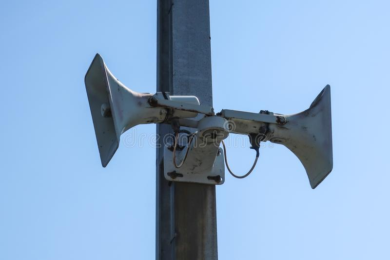 An old speaker / megaphone mounted on a post.  royalty free stock photos