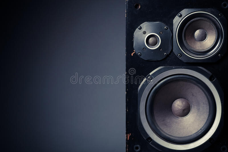 Old speakers. Detail shot of some old round speakers, with copyspace royalty free stock photo