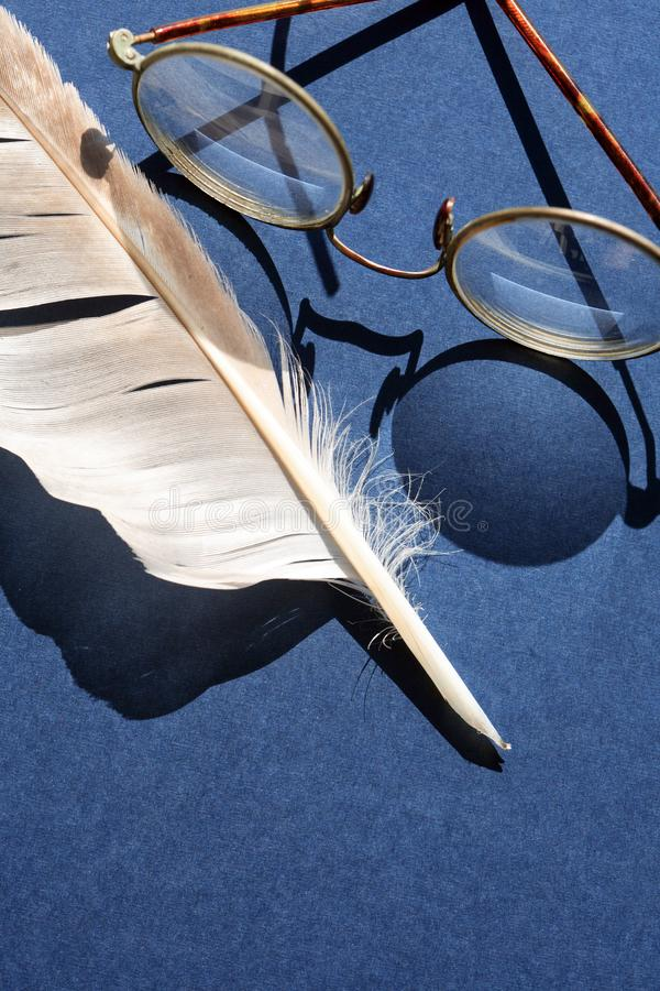Old Spectacles And Feather royalty free stock image