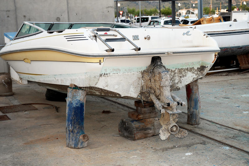 Download Old Speed Boat On Maintanence Wooden Logs Stock Photo - Image: 25438926