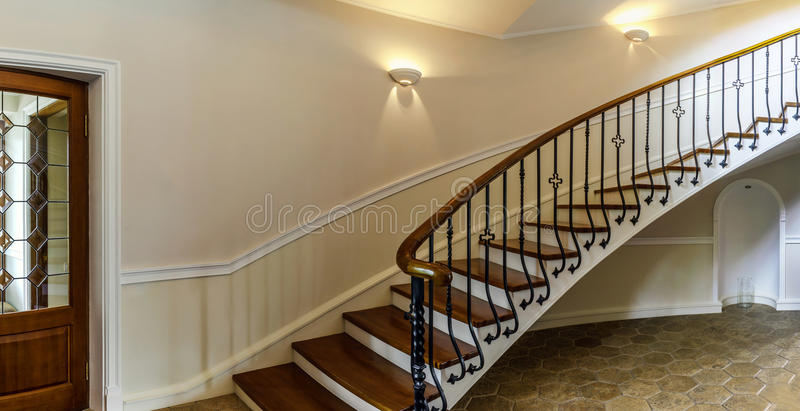 Old spiral staircase in classic russian manor style. Old spiral wooden staircase in classic russian manor style royalty free stock photo