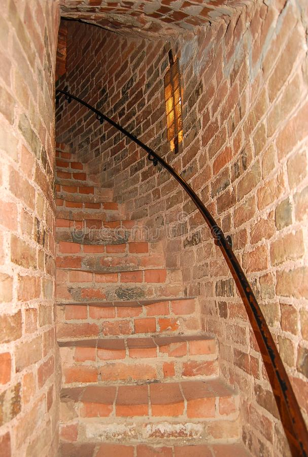 Spiral staircase in a red brick castle stock image