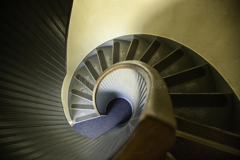 Old Spiral Staircase. A view of an old spiral staircase stock photo