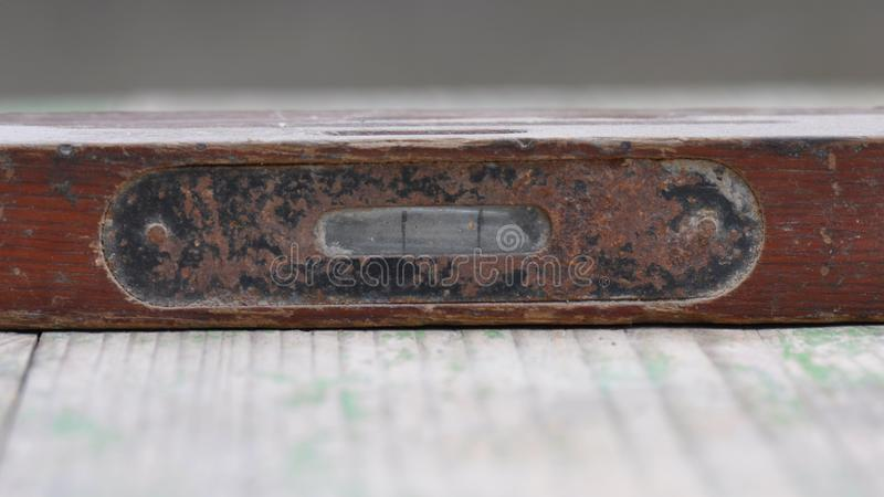 Old spirit level on wooden background stock photography