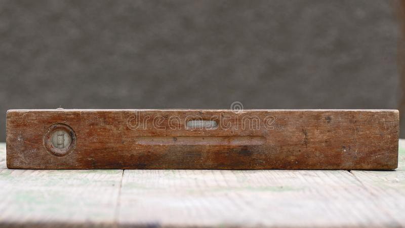 Old spirit level on wooden background royalty free stock photography