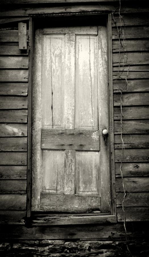 Old rustic door on abandoned house stock images