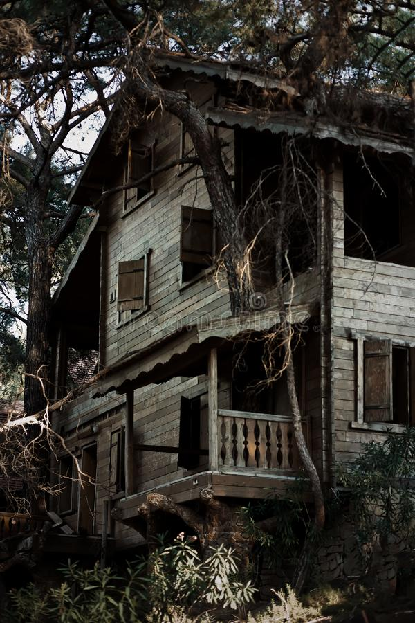 Old and spooky horror haunted house in the night royalty free stock photos