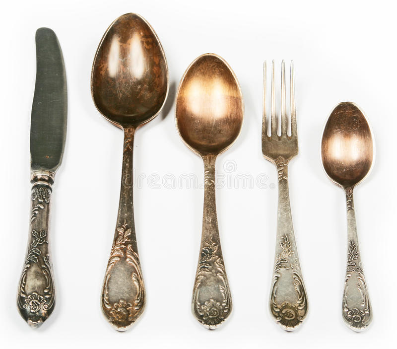 Old spoons, fork and knife. Isolated stock photography