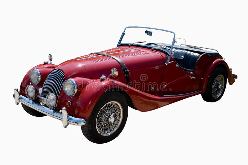 Old sport car. Vintage red british roadster isolated stock image