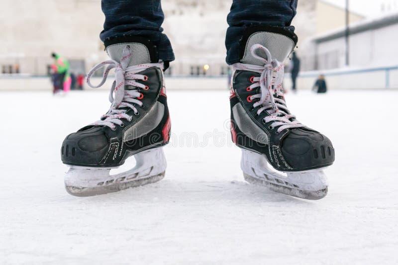 Old sports hockey skates. on a man`s leg. on the ice. royalty free stock photo