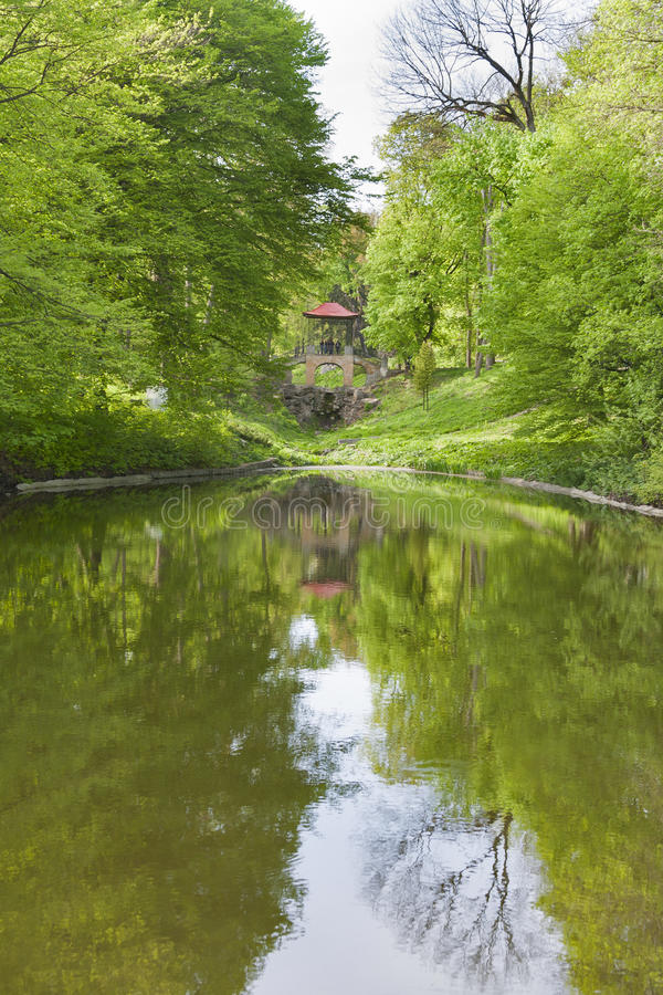 Old spring park with a pond and gazebo. Old spring park with a pond and stone gazebo stock photos