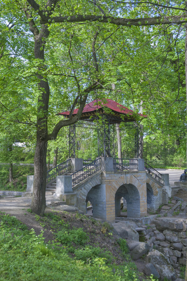 Old spring park with stone bridge. Old spring park with stone gazebo in japan style royalty free stock photos